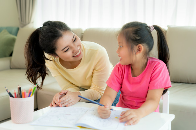 asian-mother-playing-with-her-daughter-drawing-together-with-color-pencils-table-living-room-home-parenthood-love-bonding-expression-concept_73503-1490